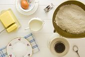 stock photo of devonshire  - Ingredients for English scones laid out on white wood above - JPG