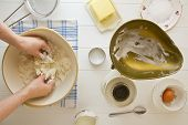 image of devonshire  - Ingredients for English scones laid out on white wood with butter being rubbed into flour - JPG