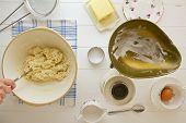 stock photo of devonshire  - A woman mixes dough to make English scones - JPG