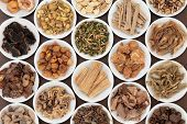 picture of ashwagandha  - Large chinese herbal medicine selection in white china bowls - JPG
