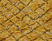 stock photo of phyllo dough  - baklava delicious oriental desert with nuts and honey syrup - JPG