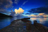foto of sea-scape  - rock bridge into blue sea against beautiful morning light sky and cloudy - JPG