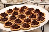 picture of tarts  - Sweet chocolate mini tart on the food table - JPG