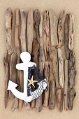 pic of driftwood  - Decorative anchor with abstract driftwood design on beach sand background - JPG