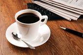 stock photo of peppy  - cup of coffee and the newspaper and pause at work - JPG