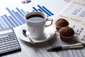 stock photo of peppy  - business still life and cup of coffee with newspapers - JPG