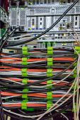 stock photo of backspace  - A lot of cables on the back server back side - JPG