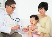 stock photo of scared baby  - Family doctor vaccines  or injection to baby girl - JPG