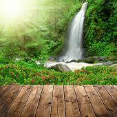 stock photo of cataract  - Beautiful waterfall with wooden planks - JPG