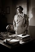 foto of 1950s style  - Attractive detective standing next to his desk 1950s style office - JPG