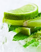 picture of peppermint  - lime slices with ice and peppermint leaves - JPG