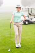 picture of buggy  - Happy golfer with golf buggy behind on a foggy day at the golf course - JPG