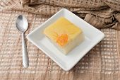 stock photo of custard  - Coconut custard made from eggs and coconut milk in white bowl on Fabric - JPG