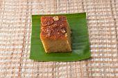 "picture of custard  - ""Mung Bean Thai Custard Dessert Recipe Khanom Maw Kaeng""(thai name) made with eggs and pumpkin Ancient thai dessert on fabric - JPG"