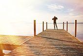 stock photo of pier a lake  - Girl on the pier - JPG