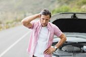 foto of nervous breakdown  - Stressed man waiting assistance after a car breakdown at the side of the road - JPG
