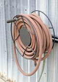 image of save water  - Water hose for watering the garden outside - JPG