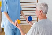 picture of physical therapist  - Senior man working out with his therapist in fitness studio - JPG