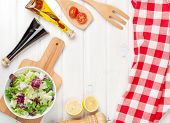 picture of condiment  - Fresh healthy salad and condiments over white wooden table - JPG