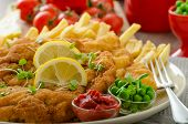 picture of pea  - Schnitzel french fries cherry tomatoes and fresh microgreens pea salad - JPG