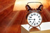 picture of morning  - Retro alarm clock in bedroom early morning - JPG