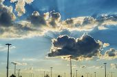 picture of horrific  - Sun rays breaking through clouds on a dramatic sunset sky - JPG