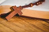 picture of rosary  - Open bible with rosary beads on wooden table - JPG