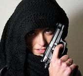 picture of gun shot  - Studio shot of a lady with scarf and gun - JPG