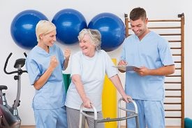 image of therapist  - Therapists with invalid senior woman in fitness studio - JPG