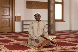 picture of islamic religious holy book  - Black African Muslim Man Reading Holy Islamic Book Koran - JPG