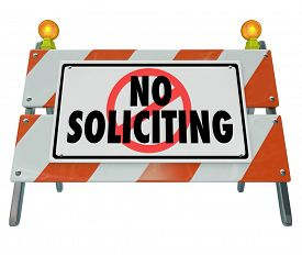 stock photo of annoying  - No Soliciting words on a barrier - JPG