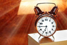 picture of analog clock  - Retro alarm clock in bedroom early morning - JPG
