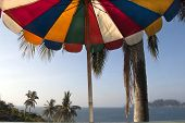 pic of phi phi  - Koh Phi Phi island in Thailand and colored sun umbrella - JPG