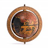pic of continent  - Old vintage wooden world globe showing the continents and sailing ships for planning a world tour geography navigation and travel isolated on white - JPG