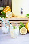 picture of mason  - Homemade lemonade in beverage dispencer and mason jars - JPG