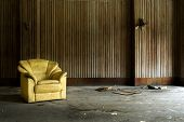 foto of abandoned house  - arm chair in abandoned house at a deserted location - JPG