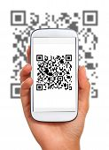stock photo of qr codes  - Scanning qr code with smart phone - JPG