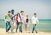 pic of nostalgic  - Group of happy friends walking a talking at the beach  - JPG
