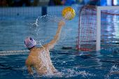 stock photo of ball cap  - water polo player during a game with ball
