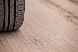 pic of dirt road  - Off road 4X4 wheel tracks on country desert beach road sand motoring background image - JPG
