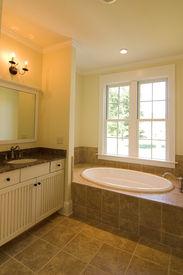 image of stone floor  - beautiful bathroom with tile floor and tub deck - JPG