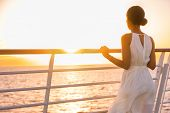 Cruise ship vacation woman enjoying sunset on travel at sea. Elegant happy woman in white dress look poster