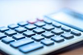 Office Calculator Close Up: Making Calculations, Savings, Finances and Economy Concept, Calculating  poster