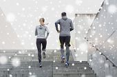 fitness, sport, people, exercising and healthy lifestyle concept - couple of sportsmen running upsta poster