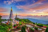 The Best Of Landscape In Chiang Mai. Pagodas Noppamethanedol & Noppapol Phumsiri At Sunset In Inthan poster