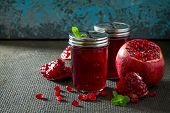 Постер, плакат: Garnet Mint And Pomegranate Juice On A Concrete Gray Background The Concept Of Healthy Nutrition A