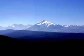 foto of mountain-range  - Wide view of a section of the snow-capped rocky mountains with trees in the foreground ** Note: Slight graininess, best at smaller sizes - JPG