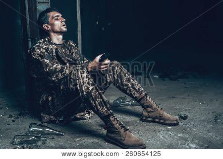 Man Is Sitting In War