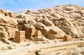 Petra panoramic view - Nabataeans capital city (Al Khazneh). Tombs made by digging a holes in the ro