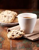 Cup of coffee and chocolate chip cookies. Symbolic image. Concept for a tasty snack. Sweet dessert.  poster
